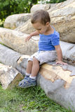 Child on wood log Royalty Free Stock Photo