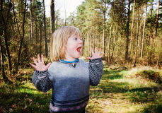Child wood scared Stock Image