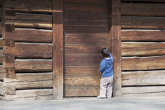 Child at wooden barn door Royalty Free Stock Images