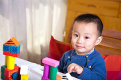 Child and wooden blocks Stock Image