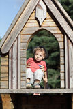 Child at wooden house Stock Images
