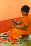 Child Worker, nice religious duty, India Royalty Free Stock Image