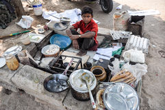 Child Worker, omelette seller, India Royalty Free Stock Photos