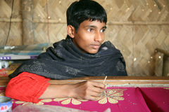 Child workers. Anandalok Naskar, 15, working on the decoration of textiles in Kumrokhali, India on Jan 16, 2009.According to the statistics there are 20 million royalty free stock photo