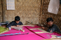 Child workers. Indrajit, 17 and Anandalok, 15, Naskar working on the decoration of textiles in Kumrokhali, India on Jan 16, 2009 stock photos