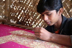 Child workers. Indrajit Naskar, 17, working on the decoration of textiles in Kumrokhali, India on Jan 16, 2009.According to the statistics there are 20 million stock photo