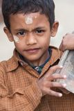 Child Workers in Nepal: boy with bricks Royalty Free Stock Photo