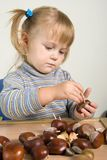 Child working. Youn girl making toy animals Royalty Free Stock Photography