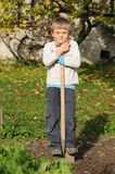 Child working in garden Royalty Free Stock Images