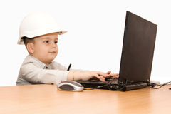 Child working at laptop. Isloated on white royalty free stock image