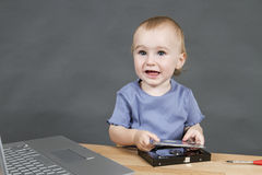 Child working at open hard drive Royalty Free Stock Photos