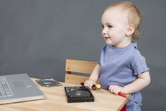 Child working at open hard drive Royalty Free Stock Image