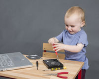 Child working at open hard drive Stock Photos
