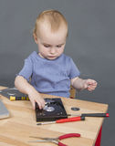 Child working at open hard drive Stock Image
