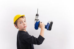 Child working wiht a drill Stock Photography