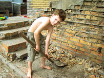 Child works. Collects broken bricks royalty free stock photos