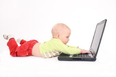 The child works on a computer Royalty Free Stock Photography