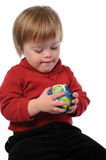 Child With World. Child with Down Syndrome holding the earth in his hands isolated over a white background Stock Images