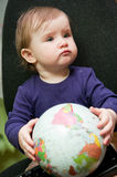 Child with world globe. Cute young preschool girl with world globe stock images