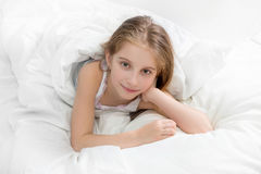Child wrapped with a white blanket, awake Royalty Free Stock Photography