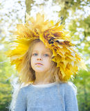 Child with wreath of autumn leaves Stock Images