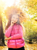 Child with wreath of autumn leaves Royalty Free Stock Photo