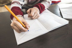 Child write in a notebook. Close up hand and pen Stock Image