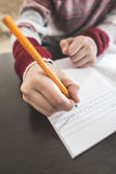 Child write in a notebook. Close up hand and pen Royalty Free Stock Photo