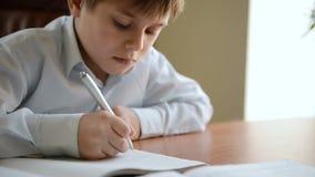Child writes homework stock footage