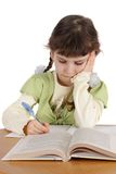 Child writes and reads Stock Photo