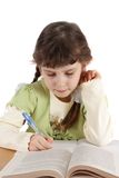 Child writes and reads. The child writes and reads on a white background, is isolated Stock Images
