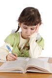 Child writes and reads, isolated Stock Images