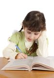Child writes and reads,isolated. Royalty Free Stock Images