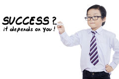 Child writes success depends on you Royalty Free Stock Photos