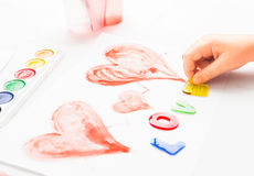 Child writes word love Stock Images
