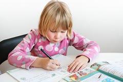 Child writing Stock Photos