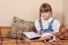 Child writing Royalty Free Stock Photography