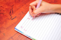 Child writing alphabet Royalty Free Stock Photo