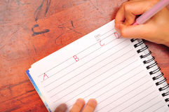 Child writing alphabet Royalty Free Stock Photography