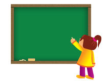 Child writing on chalkboard Royalty Free Stock Image
