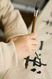A child writing Chinese Calligraphy stock images
