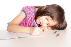 Child writing at desk Stock Photo