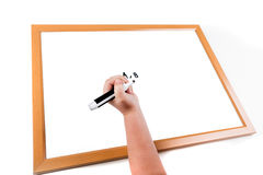 Child writing on a dry erase board Royalty Free Stock Photography