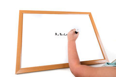 Child writing on a dry erase board Stock Photos