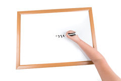 Child writing on a dry erase board Stock Photography