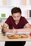 Child writing homework at school Stock Photo