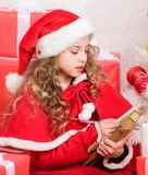 Child writing letter to santa claus. Dear santa. Girl little cute child hold pen and paper near christmas tree. Believe royalty free stock photos