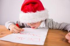 Child writing letter to santa Stock Photos