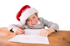 Child writing letter to santa Stock Photo