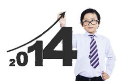 A child writing the new year 2014 Royalty Free Stock Photos